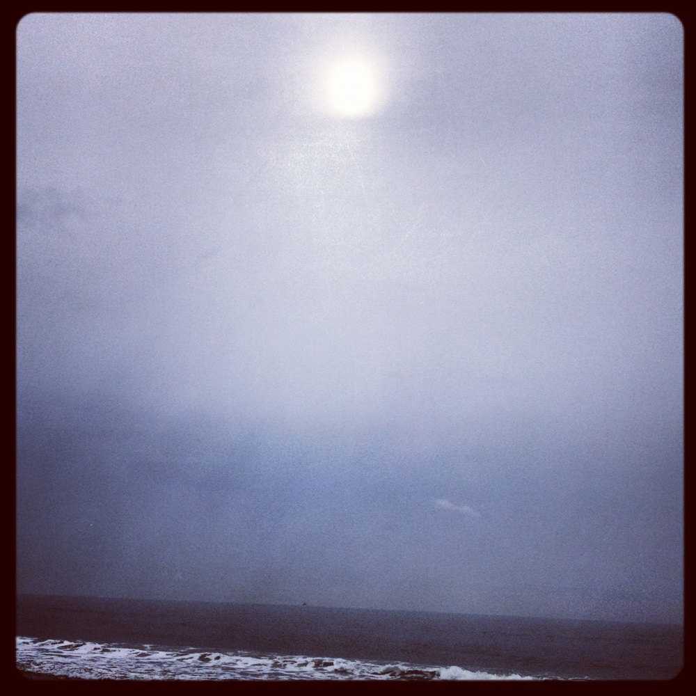 A walk on the beach during a cloudy morning, where the sun peeked out resembling the moon.  True soul shine for me~